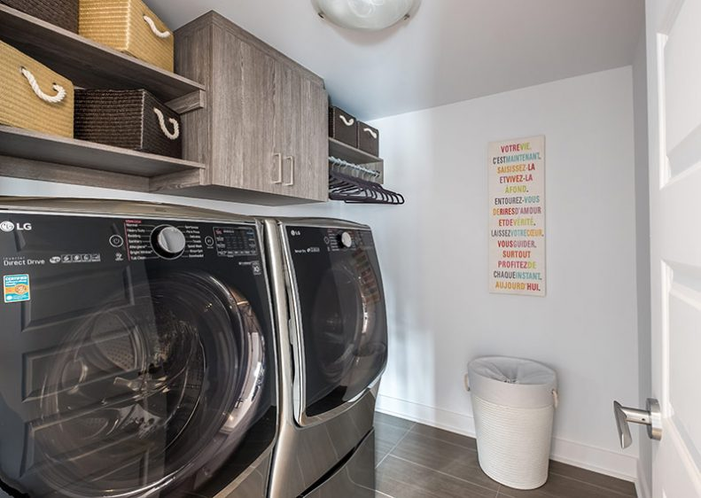 A laundry room with storage