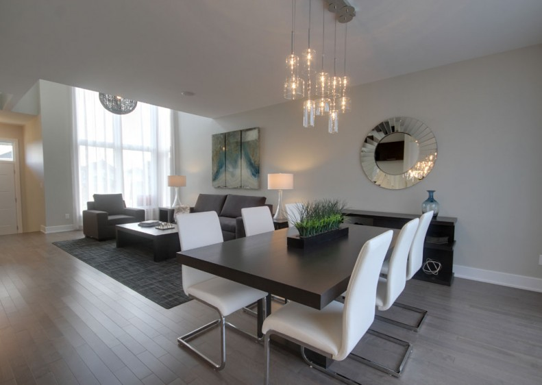 Living room and dining room at our prestigious home in Laval