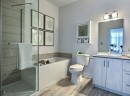 A refined bathroom with a tub to relax in and a shower for those hurried mornings