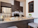 A kitchen with a modern design and an ideal counter to enjoy your coffee in the morning