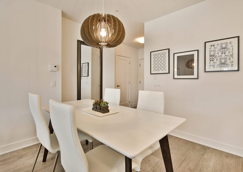 A minimalist-style dining room that blends in perfectly with the design of this superb condominium