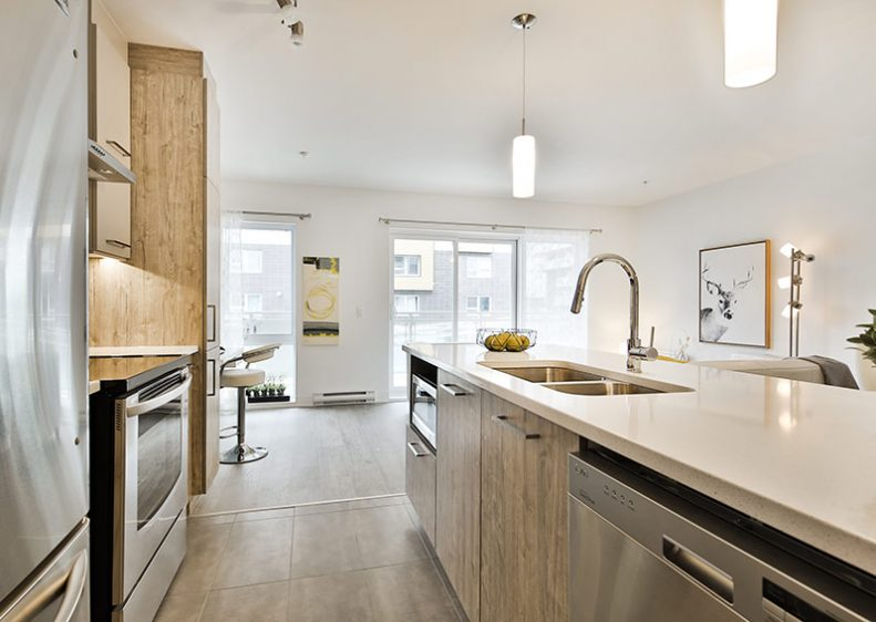A modern and bright kitchen in the fully refurbished model unit at Le Logix Condos